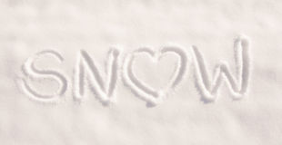 Word snow with a heart, written in pure, fresh snow Royalty Free Stock Image