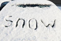Word snow on windshield of car Stock Photo