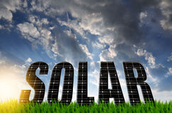 The word Solar from solar energy panels. Against sunset sky Royalty Free Stock Photo
