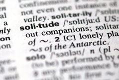 The word solitude  in a dictionary Royalty Free Stock Photo