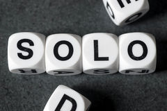 Word solo on toy cubes. Word solo on white toy cubes royalty free stock images