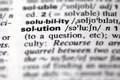 The word solution in a dictionary. Close-up of the word solution in a dictionary Royalty Free Stock Photo