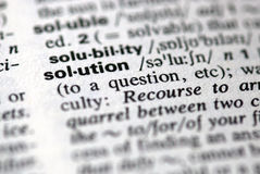 The word solution in a dictionary. Close-up of the word solution in a dictionary Stock Image