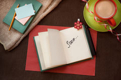 Word Soon in notebook on vintage style background Royalty Free Stock Images