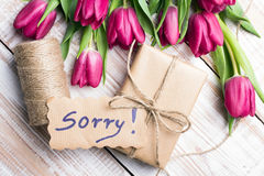 Word SORRY and bouquet of tulips Royalty Free Stock Photo