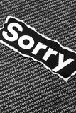The word sorry. A closeup of the torn printed word sorry on a background of the word today Royalty Free Stock Image