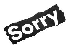The word sorry. A closeup of the torn  printed word sorry on a white background Royalty Free Stock Photography
