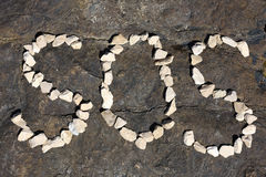 Word Sos. Sos inscription on the sea shore stock images