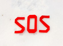 The word sos on a snowfield Stock Photos
