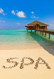 Word Spa on beach Royalty Free Stock Photography