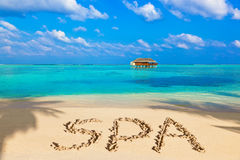 Word Spa on beach Royalty Free Stock Image