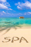 Word Spa on beach Stock Images