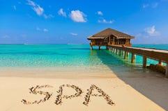 Word Spa on beach Royalty Free Stock Photo