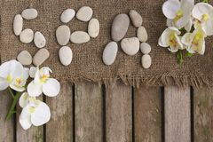The word spa done with river pebbles. Background Stock Photos