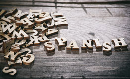 Word spanish made with wooden letters. Stock Photo