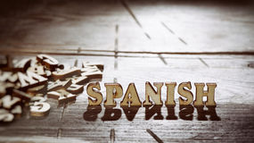 Word spanish made with wooden letters. Stock Image