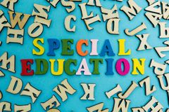 The word `special education` is laid out from multicolored letters on a blue background royalty free stock photo