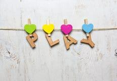 Word spel met houten brieven op een witte achtergrond Royalty-vrije Stock Foto's