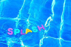 Word SPLASH floating in a swimming pool Stock Photo