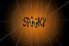 Word spooky hanging in the center of a spider web Stock Images