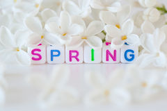 The word spring with flowers Stock Photo