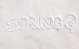 Word spring? scribbled in snow Stock Photo