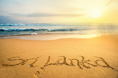 Word Sri Lanka written on a tropical beach stock photos