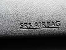 The word SRS Airbag symbol inside car for safety Stock Photo
