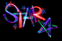 Word star. The five-pointed stars and word Star on black. Freezelight photo Stock Photos
