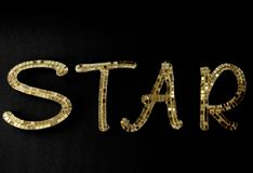Word `Star`created out of gold mirrored letters. Bling gold mirrored letters create the word `STAR` for the theatrical type royalty free stock photography