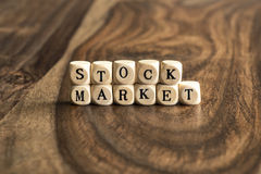 Word STOCK MARKET on wooden cubes Royalty Free Stock Photo