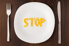 Word stop made of corn seeds on a plate Stock Photo