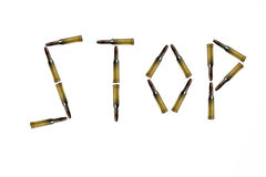 The word STOP made of rifle bullets. On a white background Royalty Free Stock Photography