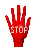 Word stop written on a hand palm colored in red, on white Royalty Free Stock Images