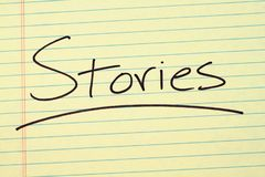 Stories On A Yellow Legal Pad. The word `Stories` underlined on a yellow legal pad Royalty Free Stock Photo