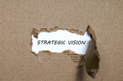 The word strategic vision appearing behind torn paper Royalty Free Stock Photography
