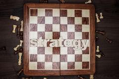 Word strategy on wooden background Royalty Free Stock Images