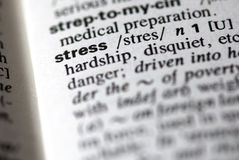 The word stress in a dictionary. Close-up of the word stress in a dictionary Stock Photos