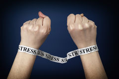Word stress on person hands. Paper strips with word Stress on person hands. Closeup Stock Images