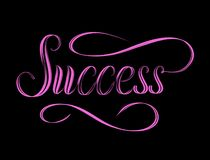 The word Success hand lettered in glowing pink. stock photos