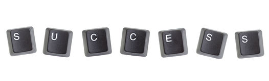 The word success is lined with keys on a computer keyboard. Royalty Free Stock Photo