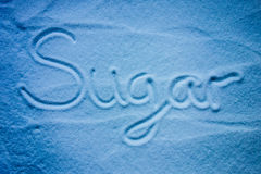 Word sugar with blue background Royalty Free Stock Images