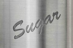 The word sugar on a metal background Stock Image
