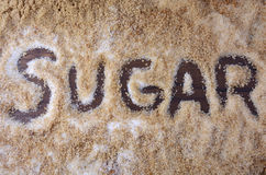 The word, sugar, written in various types of sugar. Stock Photos