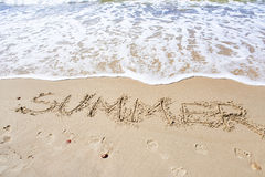 Word Summer on beach sand Royalty Free Stock Images