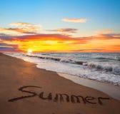 Word summer on sand sunset beach Stock Photo