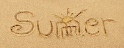 Word summer drawn in the sand Stock Image