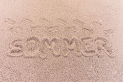 Word summer in german written on the beach. Word summer Sommer in german written on the beach Royalty Free Stock Images