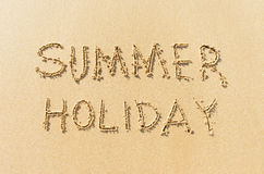 Word summer holiday on beach Royalty Free Stock Photography
