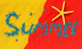 Word `summer` is laid out from blue stones on color sand stock images